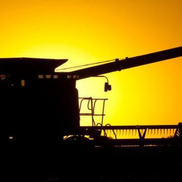 Farm Combine at Sunset
