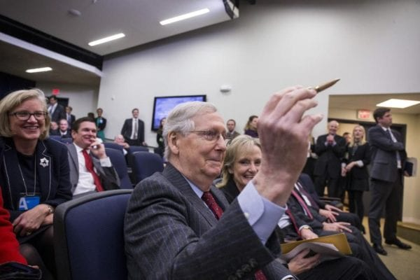 Senate Majority Leader Mitch McConnell, a Republican from Kentucky, holds a hemp pen before the start of a signing ceremony for H.R. 2, Agriculture Improvement Act of 2018, at the White House in Washington, D.C., U.S., on Thursday, Dec. 20, 2018. The Trump administration's aid package for U.S. farmers hurt by the trade war could end up saving some soybean acres next year. Photographer: Zach Gibson/Bloomberg© 2018 BLOOMBERG FINANCE LP