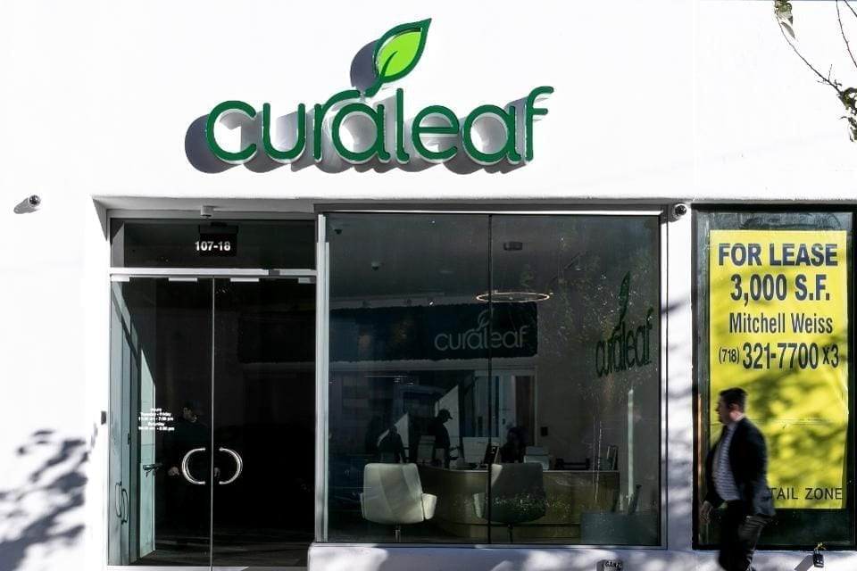 A pedestrian walks past Curaleaf Inc. store in the Queens borough of New York, U.S., on Thursday, Oct. 18, 2018. Curaleaf, a Massachusetts-based company backed by Moscow banking veteran Boris Jordan with roughly 30 pot stores open in 12 states, is raising $350 million through a private placement that values the company at about $4 billion. Photographer: Jeenah Moon/Bloomberg© 2018 BLOOMBERG FINANCE LP