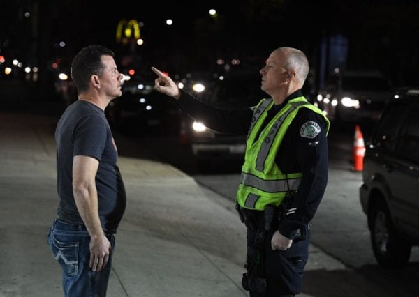 A man undergoes a sobriety test at a LAPD police DUI checkpoint in Reseda, Los Angeles, California ... [+]AFP VIA GETTY IMAGES